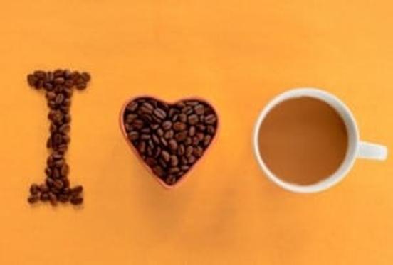 Coffee beans and coffee in a mug