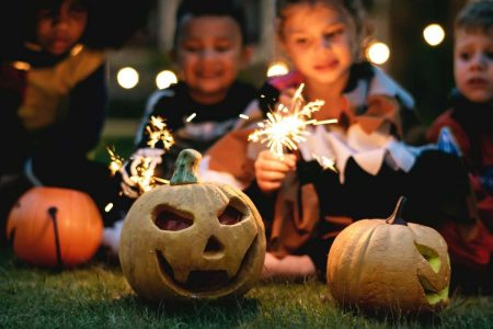 Kansas City halloween for kids - two kids in costume with sparklers and a jack-o-lantern