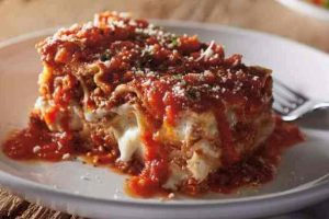 Carrabbas lasagna on a plate