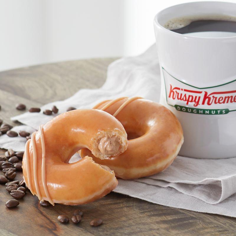 Krispy Kreme original glazed donuts and cup of coffee