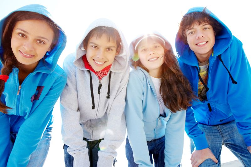 Free and Cheap Fun for kids in Kansas City - four kids dressed in hooded coats
