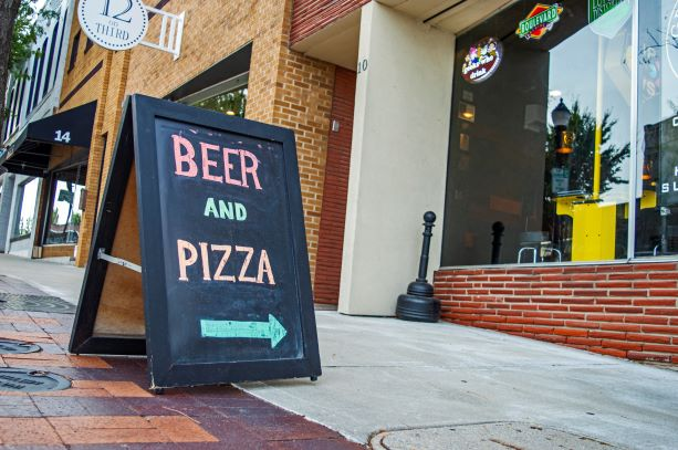 Beer and pizza sign