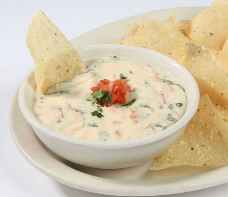 Free espinaca - bowl of espinaca queso dip with tortilla chips
