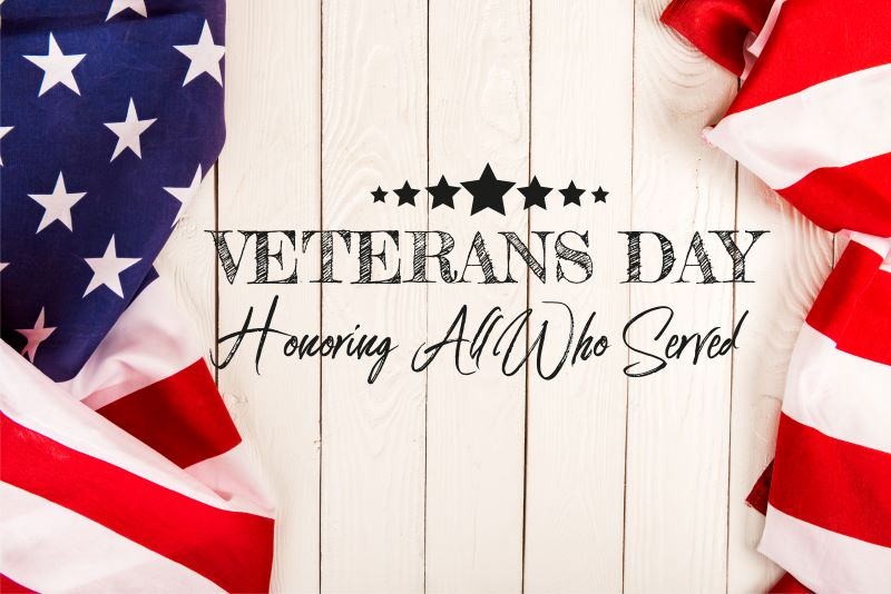 Kansas City Veterans Day activities - Wooden sign with American flag