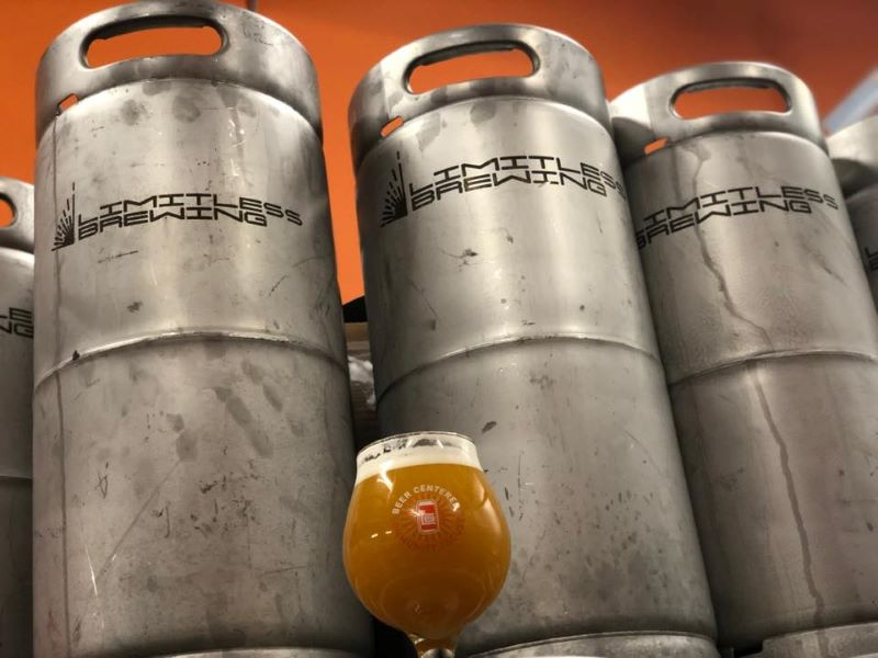 Limitless Brewing in Lenexa, KS - three kegs and a glass of beer