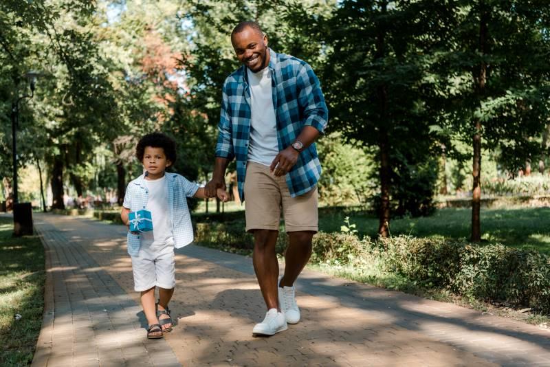 Overland Park Arboretum - parent and child walking on path