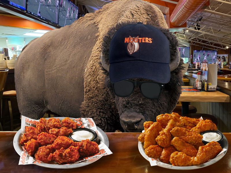 Kansas City Super Bowl Food Deals - two platters of Hooters chicken wings and buffalo in a Hooters hat