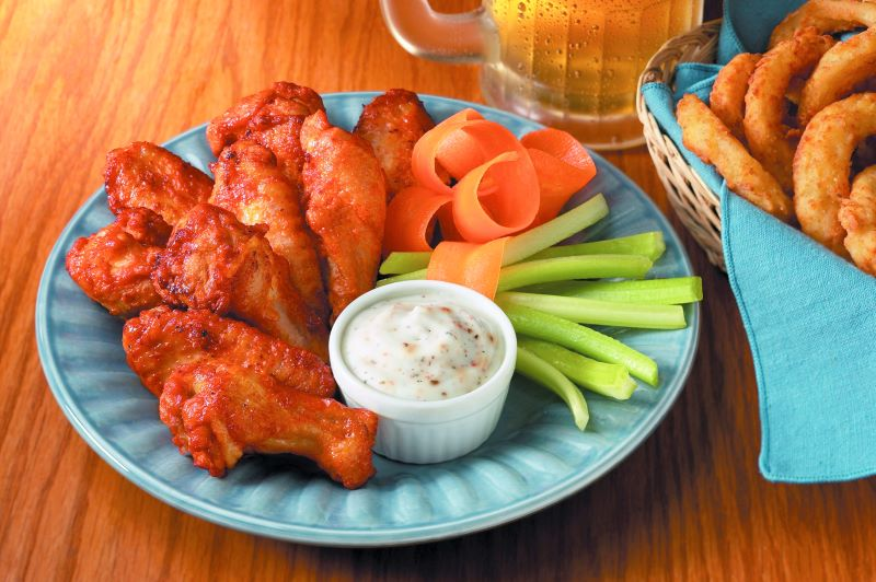 National Chicken Wing Day deals - plate of chicken wings