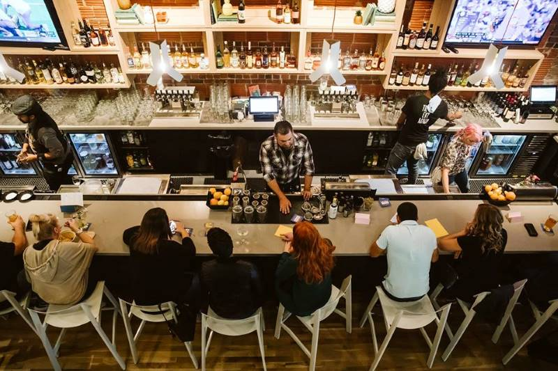 Restaurant deals in Kansas City - people sitting at abar at Parlor