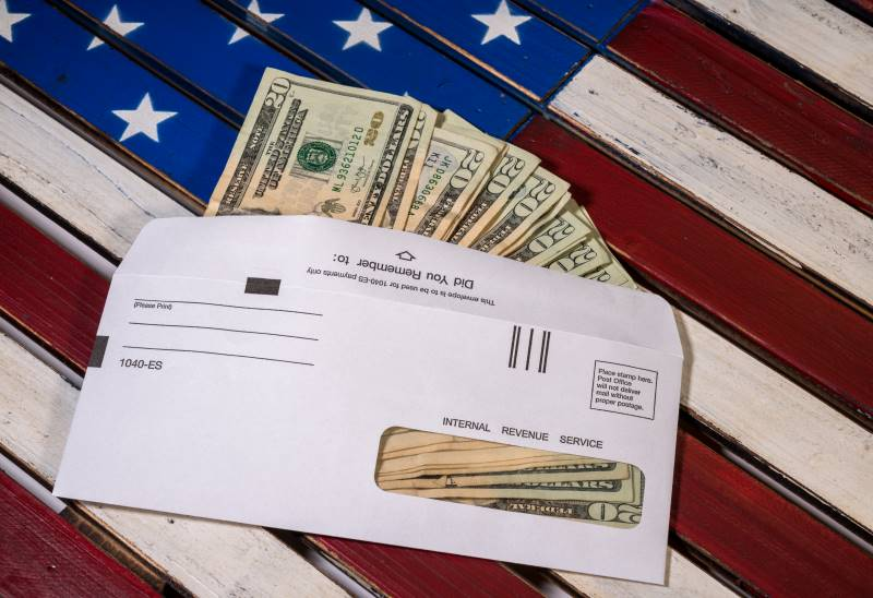 Helpful stimulus package information - cash on an American flag